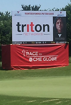 Triton Networks logo on LPGA leaderboard. Triton supplied wireless communications.
